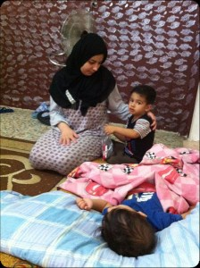 A young Syrian mother has become a refugee with two children. Photo courtesy Intercede International News Service.
