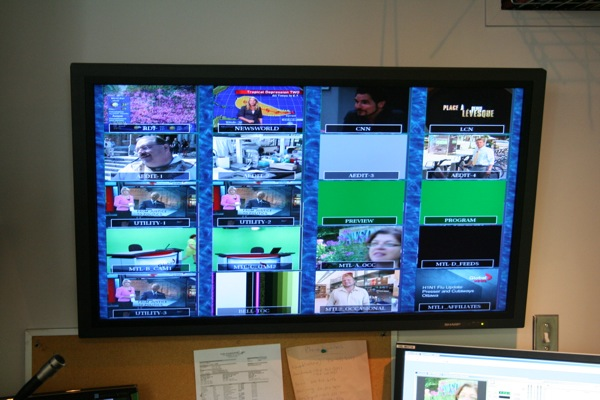 A monitor shows various video feeds from TV, satellite, studio cameras and editing booths