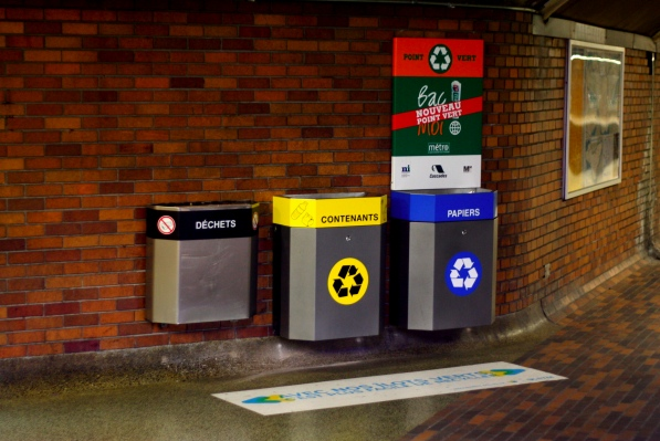 "Yellow ""contenants"" bin accepts plastic bottles for recycling"