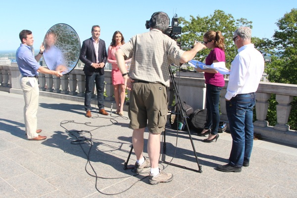 Montreal Connected staff, including production associate Sean Coleman holding a reflector (backwards, using it as a windbreaker) and Brian Murphy running the camera, shooting the show's intro and outro segments on Mount Royal.