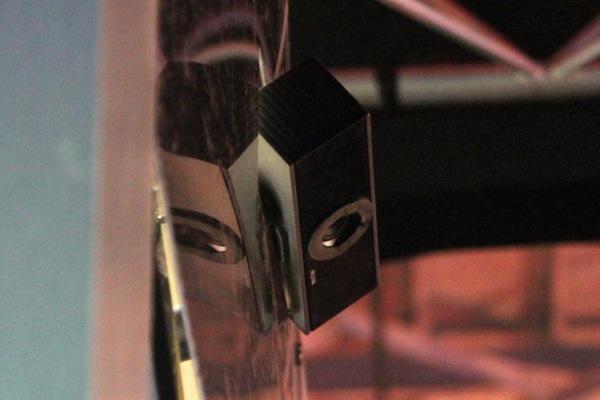 A camera above the ad screen senses movements below.