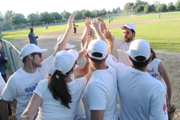 The team, led by Douglas Gelevan on the right, gives a pregame cheer.