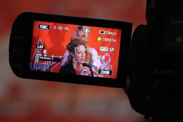 Leah Jewer's video camera, capturing the event for Virgin Radio, is one of many recording.