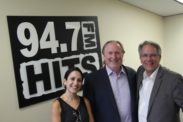 Tim Thompson, centre, heads Montreal sales for 94.7 Hits FM (WYUL) and other U.S. stations targetting Montreal.