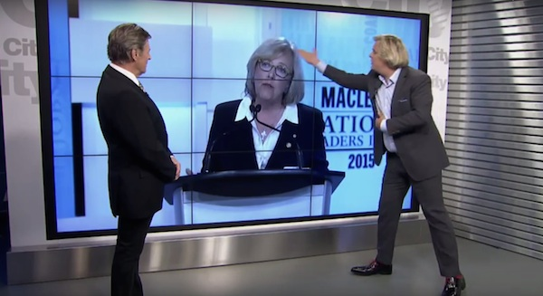 """""""Body language expert"""" Mark Bowden, right, criticizes Elizabeth May's glasses and dress during OMNI's post-debate analysis show with Gord Martineau, left."""