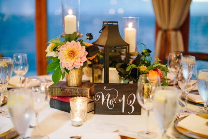 Flora Nova Design Seattle - Colorful Indian Wedding at the Edgewater Hotel. Hotel Ballroom Wedding Reception with Vineyard Chairs, Dahlia Centerpieces, gold chargers, and lanterns