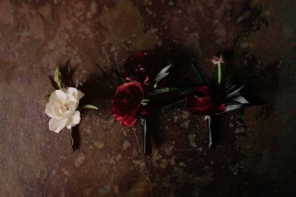 Flora Nova Design Seattle Luxe JM Cellars Wedding. Boutonniere, ranunculus, black feathers