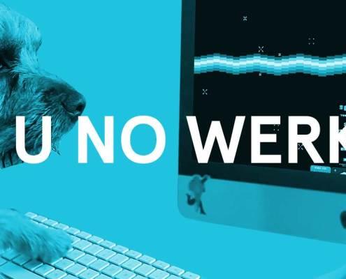 Dog looking at computer screen with caption 'y u no werk?'