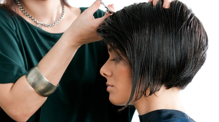 Young beautiful woman at the hairdresser salon