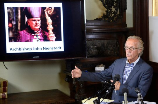 Jeff Anderson, a lawyer for victims of clergy abuse, with a photo of Archbishop John C. Nienstedt of St. Paul and Minneapolis.