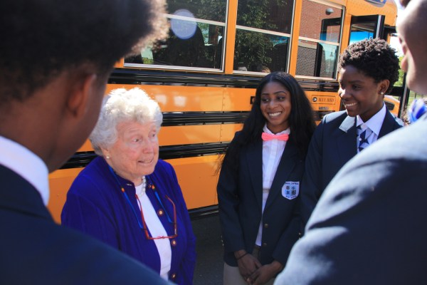 Sally Chubb speaks with students from Central High School after the announcement Wednesday.