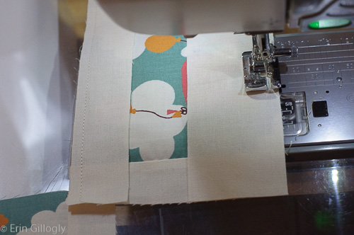 image of a sewing machine and fabric being sewn together