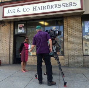Salon owner Latosha Jackson-Martin interviewed by a local TV crew, April 2015.