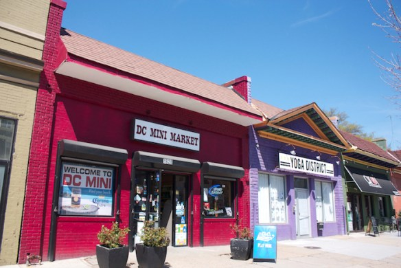 Older businesses share street fronts with newer ones like this yoga studio in Washington's Bloomingdale neighborhood.