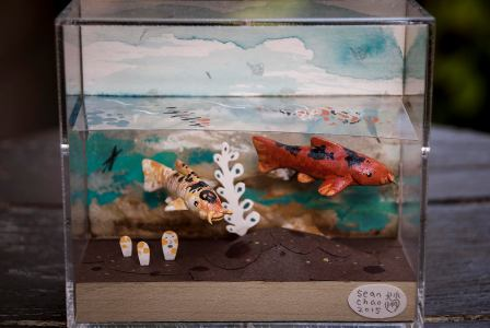 Learn to make a piece like this in this weekend's Water Memory workshop. Sean Chao, Skull Koi 2, 2015, bass wood, polymer clay, acrylic, and gouache paint on wood panel. Photo courtesy of the artist.