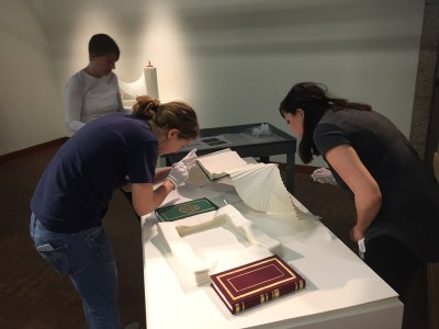 Maggie gets some help with Miri Golan's book piece. Photo: Vicky Murakami.