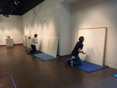 Condition reports have to be performed on every incoming piece before it gets installed. Here, Christina and JANM's Maggie Wetherbee inspect works by Yuko Nishimura. Photo: Vicky Murakami.