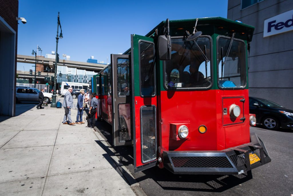 NY Trolley transport for a Ladies Pavilion wedding by NYC wedding photojournalist, Kelly Williams