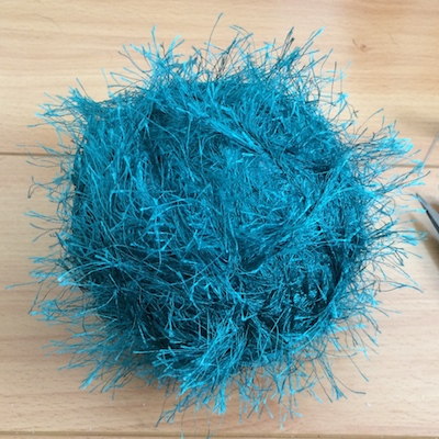 wrap the yarn around the foam ball