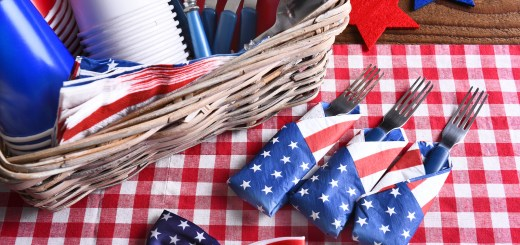 High angle view of a patriotic picnic table set for a 4th of July celebration. Horizontal format.