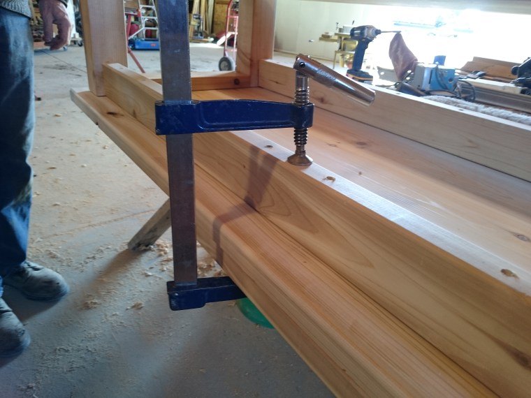Clamps to the rescue. Pulling it tight before screwing the frame into the top was essential.