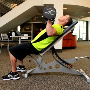 Bryant doing a dumbbell incline press at LA Fitness - A