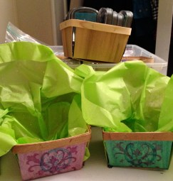 Tissue-paper lined finished baskets, with craft supplies stored in more baskets in background.