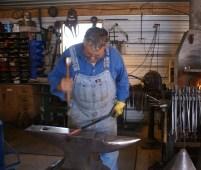 Doug's using a mirror finish hammer. He built the head himself.