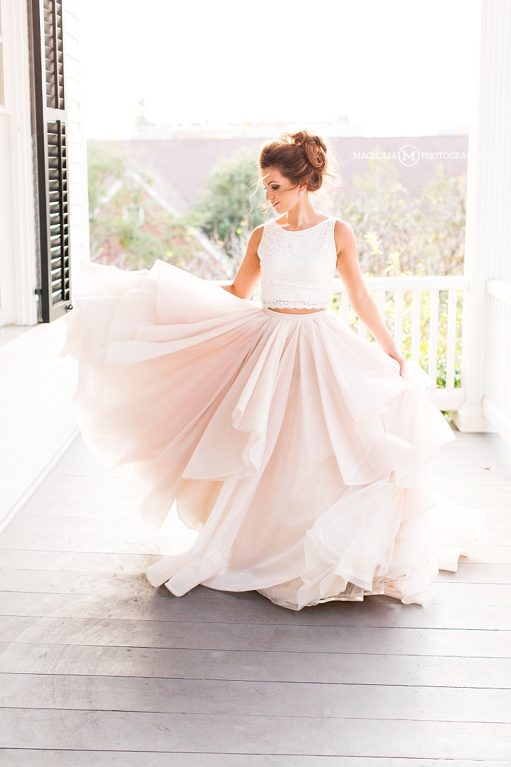 bride in blush skirt and lace crop top