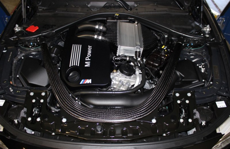 stock-bmw-m4-engine-bay-1024x664