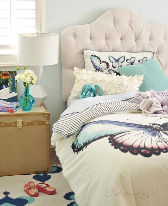 tufted-headboard-and-gold-chest