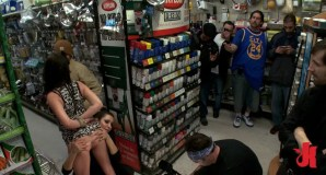 Brunette with lovely holes gets exposed in a hardware shop full of horny men