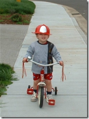 Kenny on the bike with his fire hat
