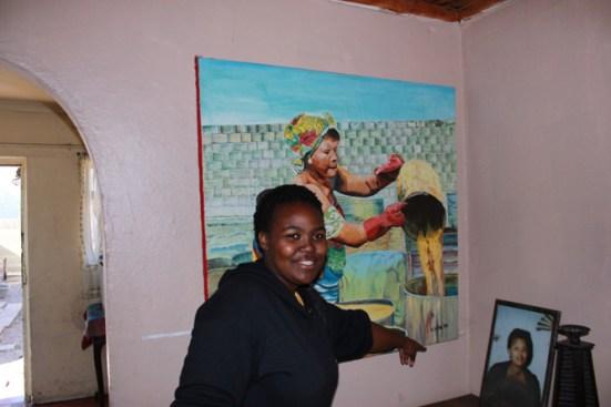 Xola enjoys the work of Velile