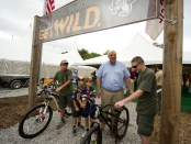 Scouts Lance Leve, Preston Core, Jackson Core, and Chris Wunderly (from left) show West Virginia businessman and philanthropist Jim Justice a pair of bikes that will be used when the Summit Bechtel Family National Scout Reserve opens in 2013.