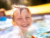 Child swimming in pool