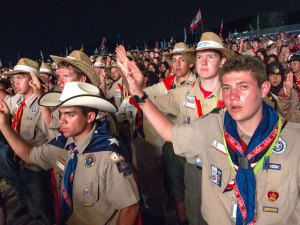 Scouts at 2015 World Jamboree holding up Scout sign