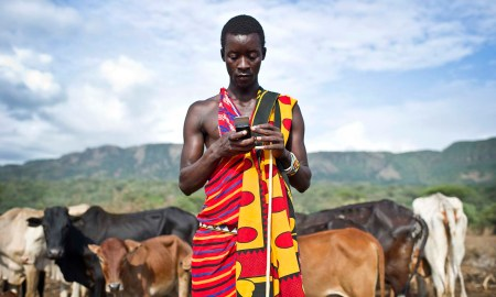 A Maasai pastoralist checks his mobile phone in southern Kenya