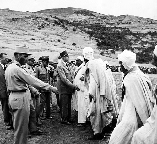 Charles de Gaulle, president of France, meets some Algerians in August 1959; photo credit.