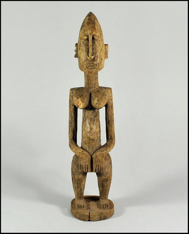 "Depiction of Dogon God ""Amma "" Shown like many ancient God's with an elongated head."
