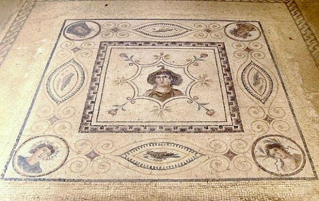 A 2nd-century CE mosaic of Goddess Africa with Four Seasons at the corner, in El Djem Museum Tunisia