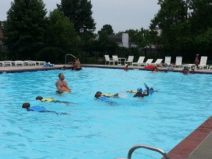 Children in one of the more advanced groups practice swimming on their backs