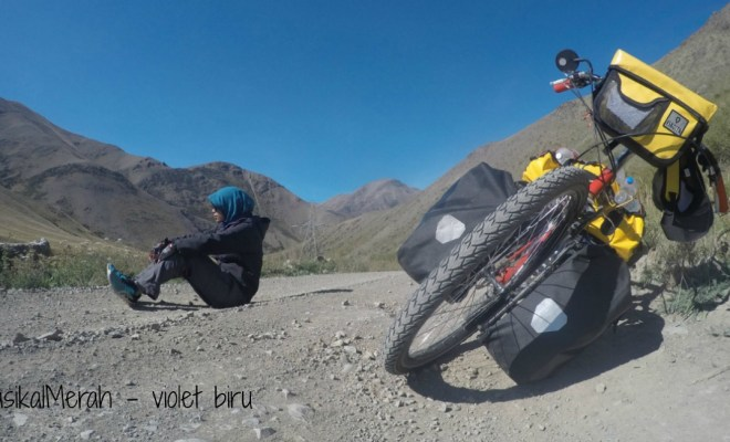Violet Biru female solo traveler on a bike
