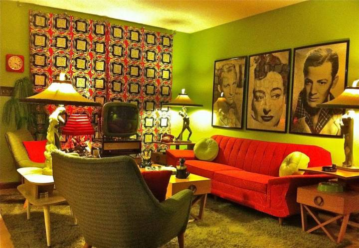 retro-living-room-ideas-with-green-walls-and-wall-gallery-and-tapestry-and-red-sofa-and-green-side-chairs-and-tables-and-green-shag-rub-and-table-lamps