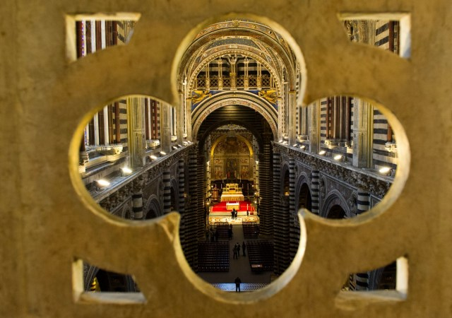 """SIENA, ITALY - APRIL 05:  A view of the nave from the balcony under the roof  seen during the press preview of """"La Porta del Cielo"""" at Duomo on April 5, 2013 in Siena, Italy. The newly launched """"Door to Heaven"""" from April 6th will allow visitors to enjoy a spectacular new view of the Duomo and the city of Siena.  (Photo by Marco Secchi/Getty Images)"""