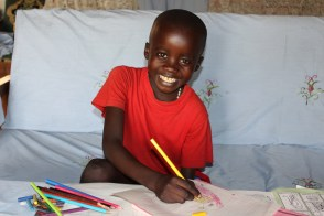 Cleophas draws a picture for his sponsor.