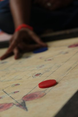 A child in India plays Carom.