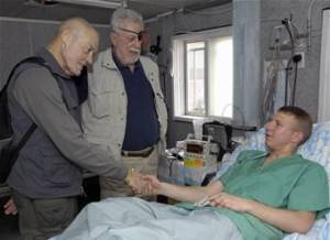 Colonel Howard, USA, and Colonel McGinty, USMC, Medal of Honor Recipients, visit a wounded soldier.
