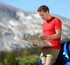 man-looking-at-a-map-beside-his-car-rental-dp