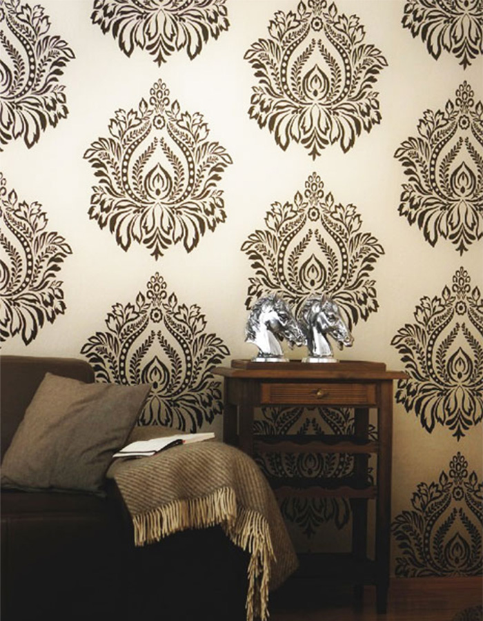 black and white flocked large scale damask orbit wallpaper in a living room by walls republic